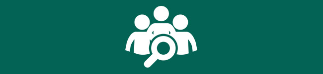 Icon of a group of people with a magniifying glass