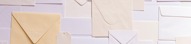 A collection of white and cream coloured envelopes