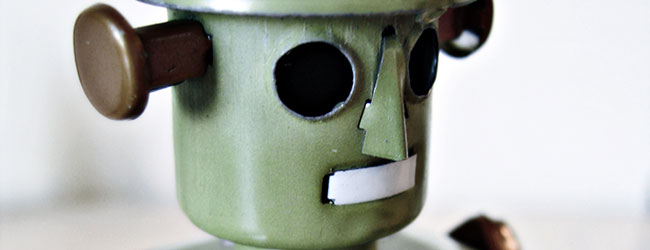 A dull green grey toy robot