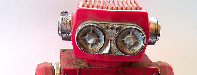 A bright red but slightly dirty toy robot