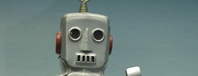 A steel grey toy robot