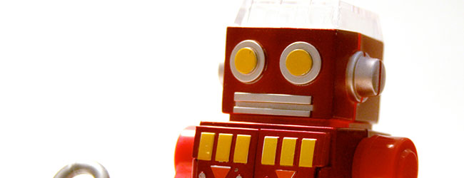 A bright red and yellow toy robot