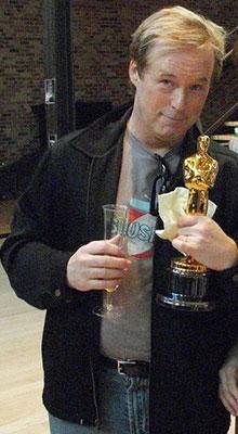 Brad Bird holding his Oscar