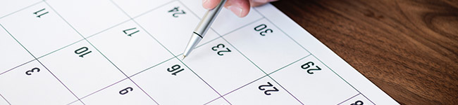 A person marking a day on a calendar