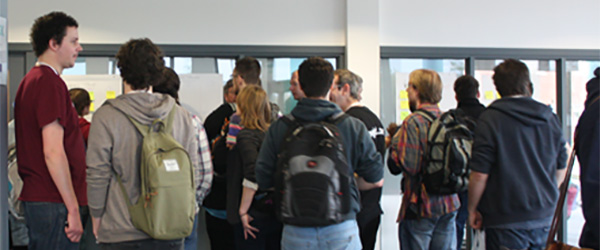 Attendees waiting for a talk at the PHPem Unconference