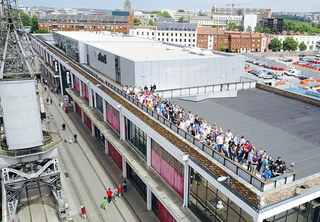 2017 Pixel Pioneers attendees standing on the patio of the M Shed