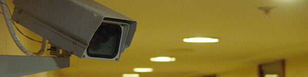 Photo of a CCTV camera in a hallway